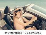 young woman drive a car on the... | Shutterstock . vector #715891063