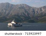 a ferry brings tourists to an... | Shutterstock . vector #715923997