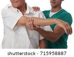 senior man having chiropractic... | Shutterstock . vector #715958887