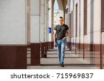 the guy is walking around the... | Shutterstock . vector #715969837