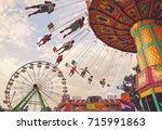people riding rides and... | Shutterstock . vector #715991863