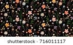 cute pattern in small flowers....   Shutterstock .eps vector #716011117