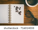 white cup of coffee  eyeglasses ... | Shutterstock . vector #716014033