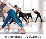 group asian women stretching... | Shutterstock . vector #716020573