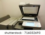 the canon printer in the office ... | Shutterstock . vector #716032693