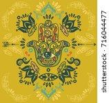 hamsa symbol with hand drawn... | Shutterstock .eps vector #716044477