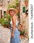beautiful pretty woman walking... | Shutterstock . vector #716098207