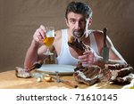 Man eating smoked pork meat and drinking beer - stock photo