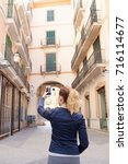 rear view of young tourist... | Shutterstock . vector #716114677