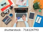 woman working at office desk... | Shutterstock . vector #716124793