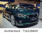 Small photo of FRANKFURT - SEPTEMBER 12, 2017: BMW ALPINA B4 S Bi-Turbo Cabrio is on display at 67th IAA, Frankfurt. Engine produces 440 hp and 660 Nm, enabling to accelerate from 0 to 100 km/h in just 4.2 seconds.