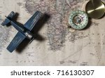 compass over map with  toy... | Shutterstock . vector #716130307