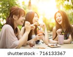 group of young woman laughing... | Shutterstock . vector #716133367