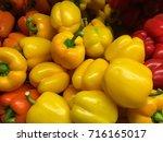 yellow peppers in store | Shutterstock . vector #716165017