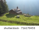An Alpine Meadow With Old...