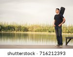 young man with  bag guitar ... | Shutterstock . vector #716212393