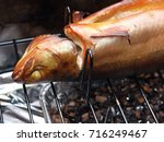 homemade smoked trout is ready... | Shutterstock . vector #716249467