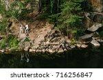 a man and a woman walk along...   Shutterstock . vector #716256847