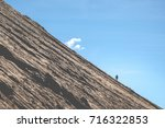 climbing a mountain on sunny... | Shutterstock . vector #716322853