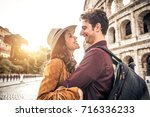 young couple at the colosseum ... | Shutterstock . vector #716336233