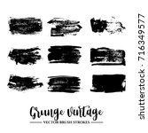 set of black brush stroke and... | Shutterstock .eps vector #716349577