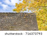 old roof littered with autumn... | Shutterstock . vector #716373793