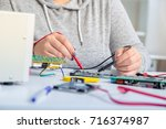 repair on electronic printed... | Shutterstock . vector #716374987