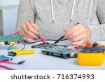 repair on electronic printed... | Shutterstock . vector #716374993