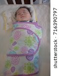 Small photo of Baby sleeping in Swaddle, a boy