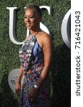 Small photo of NEW YORK - AUGUST 28, 2017: Chairman of the Board, CEO and President of the USTA Katrina Adams on the blue carpet before US Open 2017 opening night ceremony at Tennis Center in New York