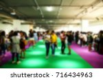 the blurry photo crowd of the... | Shutterstock . vector #716434963