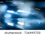 cars driving on flooded road... | Shutterstock . vector #716445733