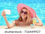 beautiful young woman taking... | Shutterstock . vector #716449927