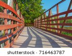 Small photo of Wooden bridge in the village. Small country bridge in oal forest on a wonderful summer day