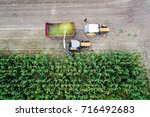 aerial view of working tractor... | Shutterstock . vector #716492683