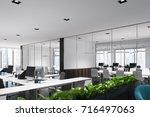 open space office with dark... | Shutterstock . vector #716497063
