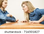 Small photo of Two women having argue mocking up being mad at each other. Female telling off, ignorance concept.