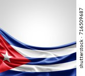 cuba flag of silk with... | Shutterstock . vector #716509687