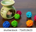 a green ceramic aromatherapy... | Shutterstock . vector #716513623