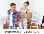 moving into new apartment.... | Shutterstock . vector #716517673