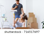 unpacking boxes and arranging... | Shutterstock . vector #716517697