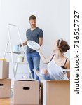 unpacking boxes and arranging... | Shutterstock . vector #716517727