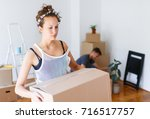 moving out. young woman... | Shutterstock . vector #716517757