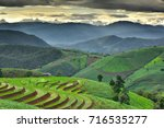 rice terrace in green season. ... | Shutterstock . vector #716535277
