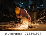 technicians use steel cutting... | Shutterstock . vector #716541937