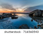 rocky dawn seascape   the... | Shutterstock . vector #716560543