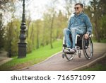 Young Disabled Man In...