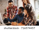 young group of designers... | Shutterstock . vector #716574457