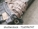 cashmere sweater and reading on ... | Shutterstock . vector #716596747