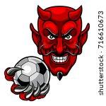 a devil cartoon character... | Shutterstock .eps vector #716610673